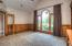 • California shag carpet • Faux painted and wainscoted walls • Cathedral ceiling • Built-in bookcases • Ceiling fan • Can lighting • Plant ledge