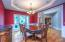 """• Hardwood flooring • Red painted walls • Tray ceiling • Hanging chandelier • 2"""" blinds"""