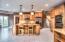 • Ceramic tile flooring • Brown painted walls • (2) Hanging lights • Granite countertops • Double bowl, stainless steel sinktop • Kenmore® built-in double oven • Kenmore® refrigerator • Kenmore® electric range • New Whirlpool® dishwasher ~2018 • General Electric® microwave • Tumbled marble backsplash • Can lighting