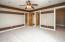 • New tan carpet ~2018 • Tan and brown painted walls • Lighted ceiling fan • Drapes remain • 1/2 round window