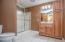 • Ceramic tile flooring • Brown painted walls • Shower stall with glass doors • Enclosed vanity with single bowl, cultured marble sinktop • 3 bulb wall light • Lighted ceiling exhaust • Wall cabinet