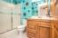 • Ceramic tile flooring • Blue painted walls • Lighted ceiling exhaust • Enclosed vanity with single bowl, cultured marble sinktop • 3 bulb wall light • Shower stall with glass doors • Mirrored medicine cabinet