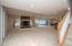 • Tan carpet • Tan painted walls • Stone fireplace with gas logs and mantle