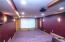 • Berber carpet • Burgundy painted walls • Can lighting • New projector ~2016 • Screen remains • Platform seating • Lighted wall sconces • Audio/visual equipment for Theatre Room only remains