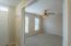1st floor den with ceiling fan and double door entry!