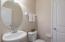 The half bath features a pedestal sink, linen closet and ceramic floors!