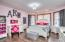 "• Hardwood flooring • Pink painted walls • Ceiling light • Bow wall • Closet with double sliding doors • 2"" blinds"