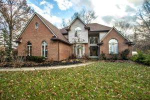 Brick, cedar, and stucco exterior. Winding asphalt drive, new drive ~2016, front porch light, coach lights, front storm door, 6 panel doors, new roof ~2017, wooded lot, keyless entry, gazebo with fabric top remains, wood windows.