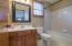 Tub/shower combo has tile surround!