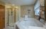 LARGE soaking tub and walk-in shower with tile surround!