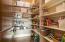Walk-in Pantry off Kitchen in back hallway