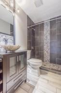 Completely updated full bath with wood-look tile and floor to ceiling tile surround in shower!