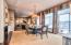 • Hardwood flooring • Tan painted walls • Crown molding • Hanging chandelier • Double sliding doors to patio/ verandah • Shades and drapes remain • See-through gas fireplace
