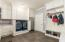 Custom Built Cabinets w/ Doors That Hide Washer & Dryer. Built-in Space for Extra Refrigerator or Freezer. (Refrigerator, Washer, Dryer in picture do not convey.) Door Leads to Over-sized 3 Car Garage.