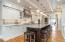 Ceiling Features Wainscoting, Beams & Recessed Lighting + 4 Pendant Lights Over Island