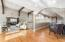 Hardwood Flooring - Recessed Lighting - Arched Entry to Loft