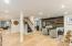 Gorgeous Engineered Wide Plank Hardwood Flooring - Plank Wood Wall as You Enter the Lower Level