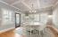 Hardwood Flooring - Plantation Shutters - Ceiling w/ Wainscoting & Beams - Exterior Door Leads to Composite Deck & Pool