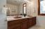 Double vanity, soaking tub, shower.