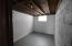This space in the basement would make a great wine cellar or storage space.