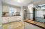 Kitchen with new appliances, hardware, sink, back splash, new sink, faucet, flooring....