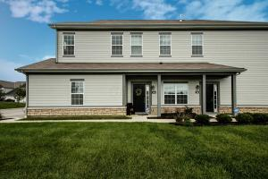 Hardiplank exterior, front porch light, white 6 panel doors, keyless entry, overlooks pond, clubhouse & green space