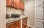 Pull out file cabinetry, granite counter tops, storage cupboards and closet