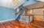 • Hardwood flooring • Blue painted walls • Hanging chandelier • Stairs to 3rd bedroom
