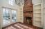 • Brick flooring • Wainscoted walls • Shelving • Bench • Cathedral ceiling • Wood burning fireplace • Chandelier • French entry doors