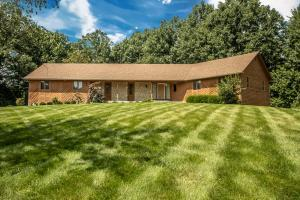 Stone and Wood exterior, concrete drive, wooded lot, keyless entry, porch light, 6 panel doors, radon mitigation system.