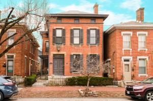 Stately & Classic! 3 story home in the heart of German Village just steps to all of your favorite places! High ceilings and doorways accent beautiful original woodwork and crown moldings. Marble and hardwood flrs throughout 1st flr. Elegant Living Room w/ w/b fplc and tall windows open to Dining Room. Family Room w/ floor to ceiling built in bookcases and w/b frpl w/ walkout to side porch. Remodeled chef's kitchen has wrap around oak cabinets, commercial gas range and granite counters w/ walkout to private fenced in brick patio. 2nd flr delights w/ 2 spacious bedrooms w/ generous closet space, large full bath + den/bedroom that opens to a balcony. LARGE private 3rd flr suite great for nanny or teen.  In addition to being the perfect urban home, it would also be an ideal B&B. A++ location!