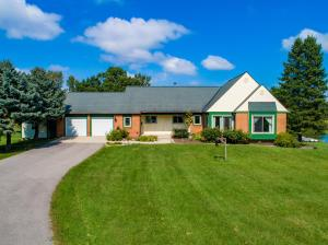 OPEN HOUSE March 10 from 2-4 p.m. Welcome home! This raised-ranch sits on more than four acres only minutes from Delaware. Close enough for easy access to all the amenities yet far enough away to peacefully enjoy nature. Five potential bedrooms including two in the walk-out lower level. Large pond is the focal point of the property with a large deck off the main level overlooking it and the patio off the lower-level leading down to the pond and dock. Main level has all new windows and sliding doors in the past two years. Both bathrooms redone in the past two years. Great home for entertaining. Lower level great in-law suite or with a little work a great Air BNB rental unit with its own entrance and amenities.
