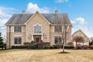 Custom built stone and stucco home by Canini on over an acre in Woodland Glen