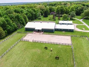front of barns and indoor arena, dry lot, front field