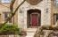 Elegant front entrance and covered alcove to greet your guests.