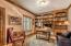 Enjoy a wall of built-ins and solid mahogany doors to the first floor office.