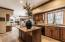 Beautifully updated, this gourmet quality kitchen features premium appliances and gorgeous granite counters and island.