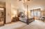 Owner's Suite featuring 2 walk-in closets, private den and stunning updated bathroom.