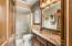 Owner's suite features water closet with glass enclosed shower .
