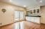Lower Level features custom built-ins and beautiful wood floors from the entrance to the kitchenette
