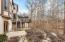 Patio space from the walk-out lower level and deck access with spectacular views to the wooded ravine and stream.