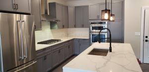 Kitchen w/ built in appliances & quartz countertops!