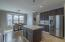 Upgraded lighting, stainless steel appliances and plantation shutters complete the kitchen!
