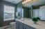 Master bathroom with oversized vanity and tub/shower combo.