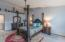 Large vaulted master suite with ceiling fan, plant ledge, ensuite bathroom and walk-in closet.