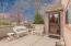 This brick condo offers a private patio!