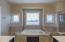 Soaking tub in the owner's suite.