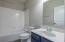 Attached to bedroom #2, this bath has a shower/tub combo.