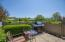 Private, fenced, cement patio with view of pond.