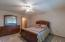 Owner's suite has a walk-in closet plus a full bath with walk-in shower.